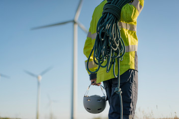 Close-up of technician at a wind farm with climbing equipment
