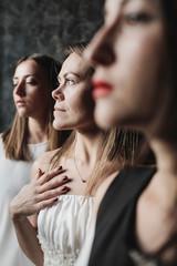 Portrait of three pensive women