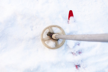 snow-covered ski and old ski pole