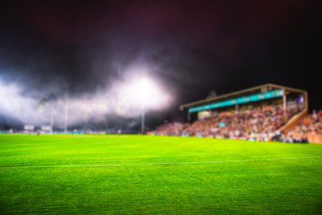 American Football Arena, Rugby. Blurred sport photo, edit space