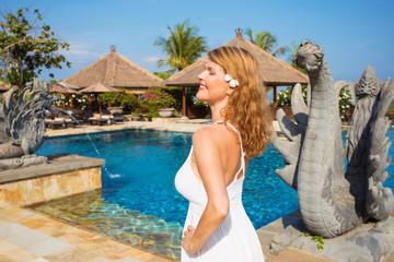 Woman enjoying vacation in tropical luxury resort