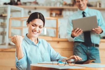 Cheerful entrepreneur getting big profit