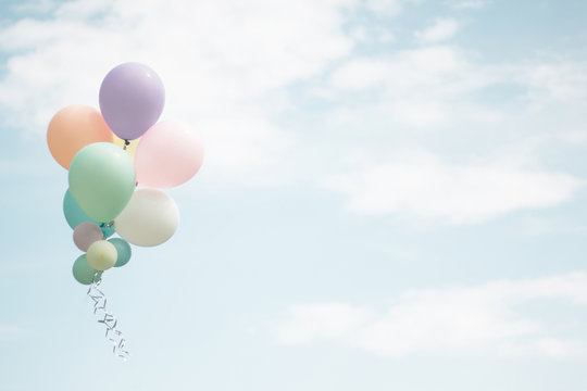 Group of soft pastel balloon with colorful on light blue sky. Concept of wedding, love, party and happy day. Use for background and greeting card.