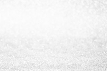 Glitter christmas abstract background. Winter christmas bokeh lights defocused.