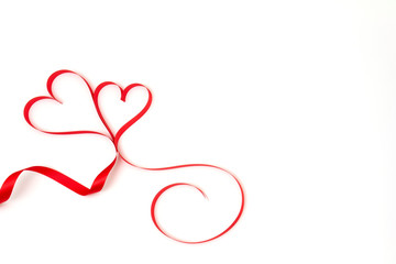 Couple red ribbon heart on white background and copy space. Love and Valentine's day concept.