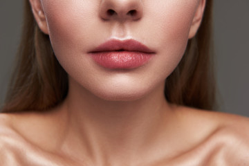 Attractive young woman with beautiful full lips