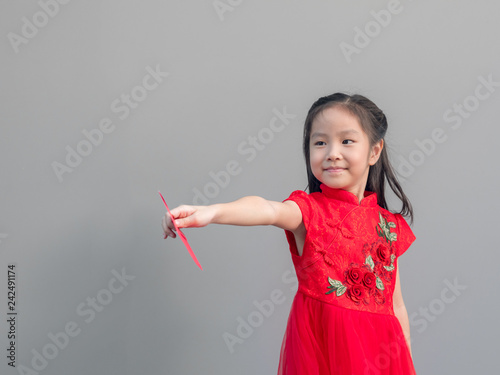 f702a8eb2bd69 Cute Asian girl in chinese cheongsam and Tradition Chinese dress with red  envelope , Chinese new year concept , grey background