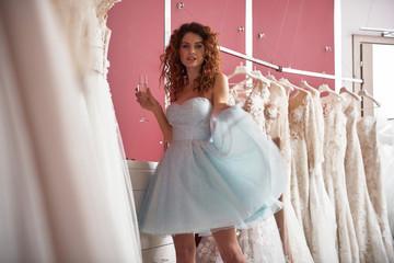 Portrait of beautiful lady flowing festal dress