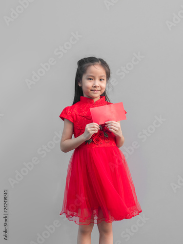 d92f5a5aa Cute Asian girl in chinese cheongsam and Tradition Chinese dress with red  envelope , Chinese new year concept , grey background