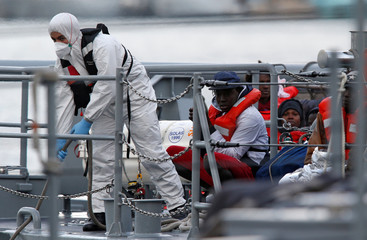 Migrants who were stranded on the NGO migrant rescue ships Sea-Watch 3 and Professor Albrecht Penck are seen on an Armed Forces of Malta patrol boat in Marsamxett Harbour