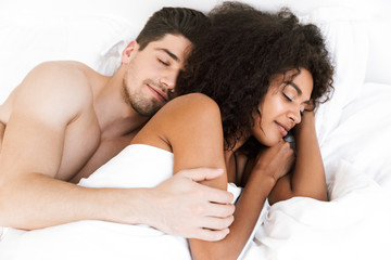 Beautiful happy young multiethnic couple relaxing