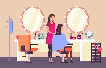 Hairdresser at beauty salon doing female haircut