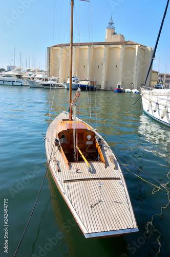 Old Wooden Sailing Boat In The Foreground Motor Boats In Front Of