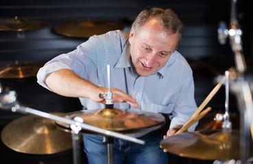 Man is choosing drum set
