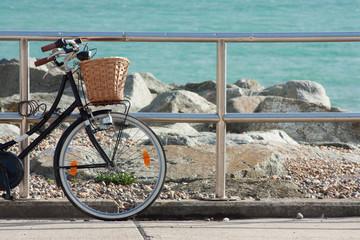 Push bike on the Promenade, Rottingdean Beach, East Sussex, UK