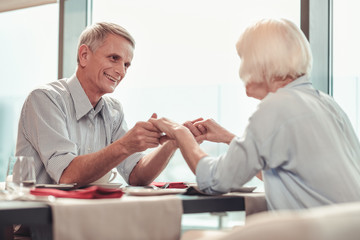 Smiling man and woman having great time together