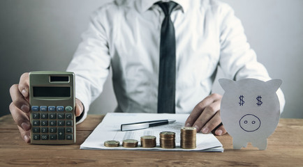Man holding calculator. Business concept
