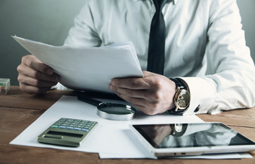 Businessman reading over the terms of the contract. Business concept