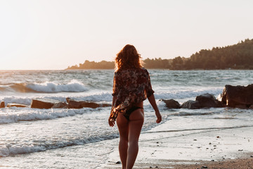 Young woman walking happy by the sea