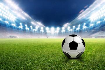Football stadium soccer with football, lights at night 3d rendering