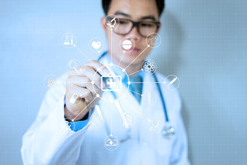 Male Doctor writing white medical icons on virtual screen HUD, medical technology network,internet of things (IOT) ai and ICT(Information Communication Technology), Health care Information concept
