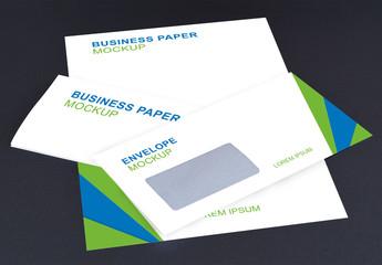 Envelopes and Letterhead on Gray Background Mockup