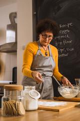 senior woman baking in kitchen