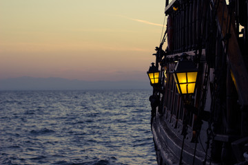 Photo sur Plexiglas Navire vintage lantern outside overboard vintage ship perspective outdoor romantic sea photography, empty space for copy or text on post card composition concept