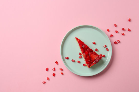 Piece of tasty cake on color background
