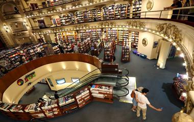 Visitors take a selfie inside El Ateneo Grand Splendid bookstore in Buenos Aires