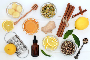 Ingredients for cold and flu remedy with ginger and cinnamon spice, eucalyptus aromatherapy oil,...