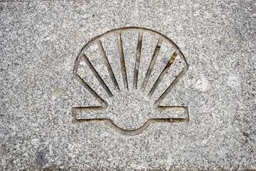 Pilgrim sign of shell mark on a street in Guimaraes, Camino de Santiago , Way of st James