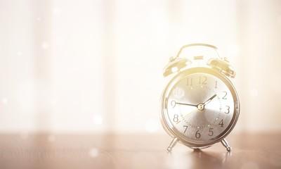 Retro alarm clock on table  background