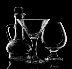 glassware for drinks on black background