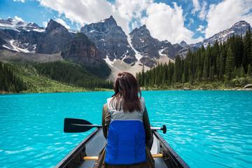 Tourist canoeing on Moraine Lake in Banff National Park, Canadian Rockies, Alberta, Canada.