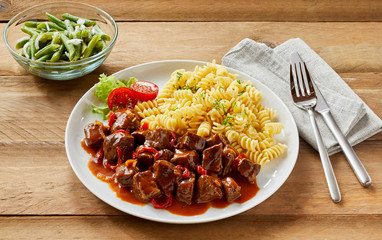 Venison goulash or stew with noodles