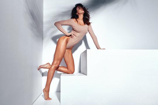 Portrait of a stretching sexy latina lady