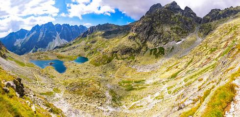 Fototapeta premium Panoramic view of Tatra mountains and Zabie lakes (Slovak: Zabie plesa, Zabie Stawy Mieguszowieckie). Hiking to mt.Rysy (2503m) in High Tatras Mountains (Vysoke Tatry), Slovakia