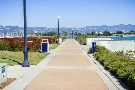 Paved walking path close to Richmond Marina, San Francisco bay trail, California