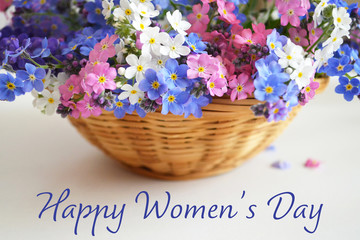 Happy Women's Day. Spring flowers in the basket