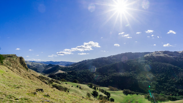 Sun shining bright over the hills and valleys of Sunol Regional Wilderness, San Francisco bay area, California