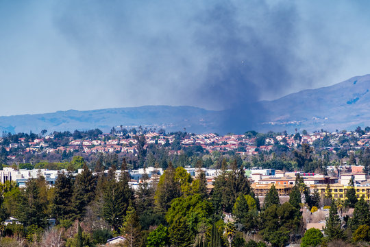Smoke from a fire rising over residential areas in south San Jose, San Francisco bay area, California