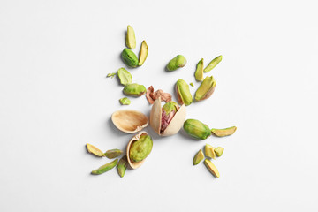 Composition with organic pistachio nuts on white background Wall mural