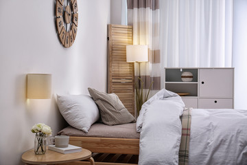 Modern teenager room interior with comfortable bed