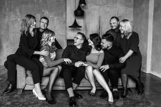Family portrait. Lovely family portrait of a big happy family sitting on a sofa and hugging each other. Black and white photo