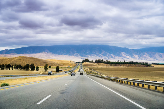 Driving through one of the rural areas of California, close to Bakersfield, on a cloudy day