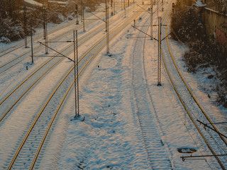 Train tracks covered in snow - evening shot