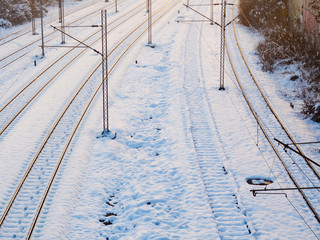 Snow covered train tracks in winter time