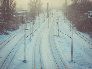 Snow covered train tracks in the evening mist