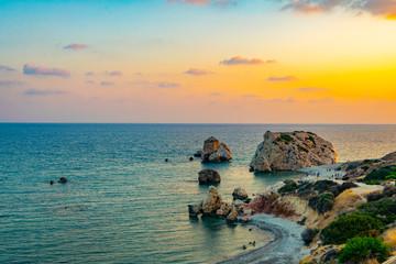 Sunset view over Petra tou Romiou alas Aphordite's rock on Cyprus